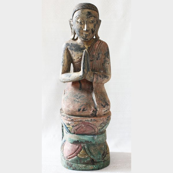 Antique Buddhist monk wood carving statue