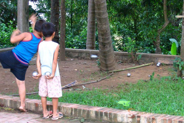 Kids Playing Boules Luang Prabang