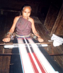 Experienced Chin weaver of tribal textiles