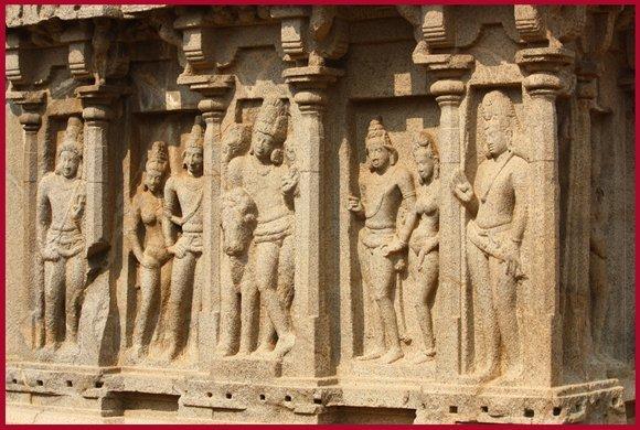 Beautifully carved sculptures of Lord Vishnu, Brahma, and Shiva at the Five Rathas, Mahabalipuram.