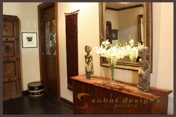 Featuring etching by Vorakorn, Burmese lacquerware box, silk wall hanging from Laos, and Indonesian wood carvings.